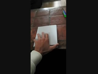 Jihoon opening his book of song lyrics