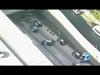 Stolen hearse containing casket, body found after pursuit on 110 Freeway in LA _