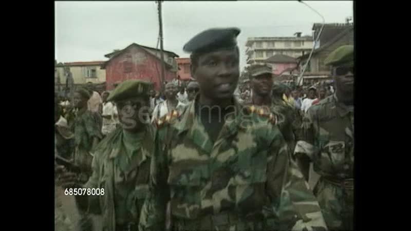 1994 EXT SLOW MOTION MS Former Sierra Leone Military Dictator Captain Valentine Strasser towards through village