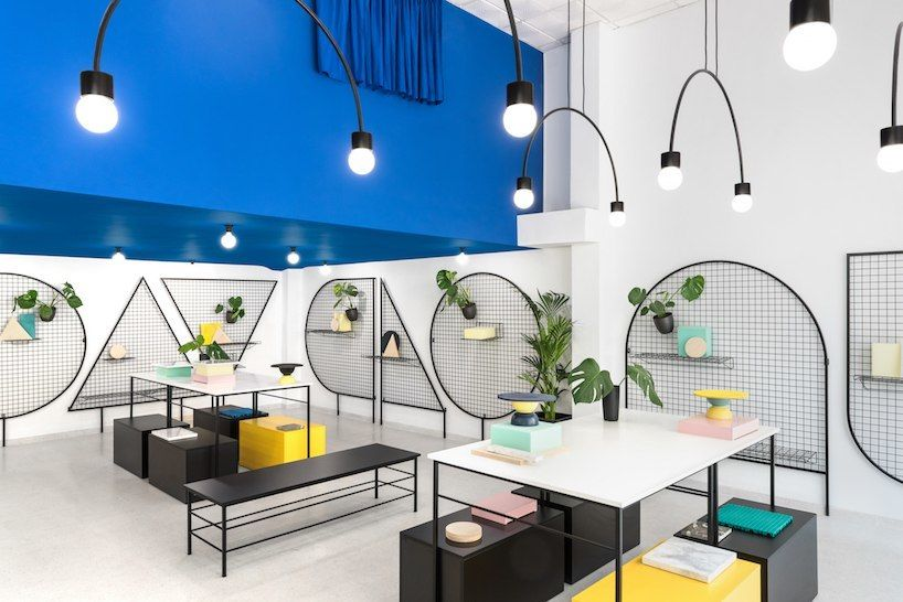 masquespacio paints valencia lifestyle store with block colors   bold lines